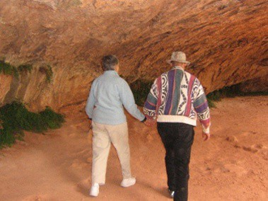 Elder Couple Walking Through Cave