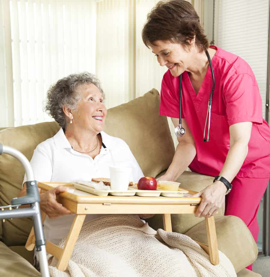 Nurse Providing Elderly Patient with Meal