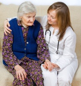 Patient Sitting with Elderly Female Patient