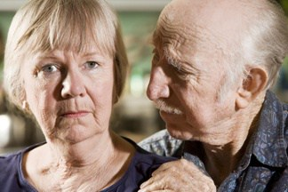 Elderly Man Looking at Elderly Woman