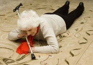 Old Woman On the Floor With Cane