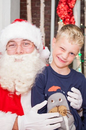 Child Standing with Santa Claus