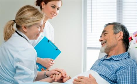 Doctor and Nurse Talking to an Elderly Patient