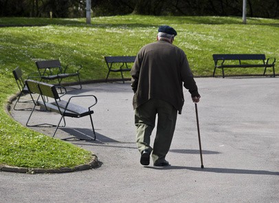 Old Man Walking in Park with Cane