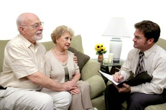 Man Talking to an Elderly Couple