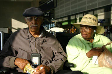 Elder Couple Sitting In Airport