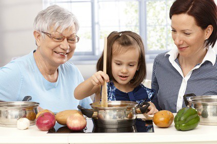Elderly Woman Cooking with Mother and Daughter