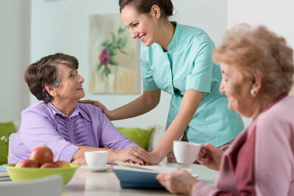 caregiver giving care to seniors