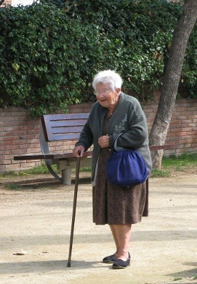 Elderly Woman Walking With a Cane