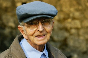 Smiling Elderly Man Wearing a Cap