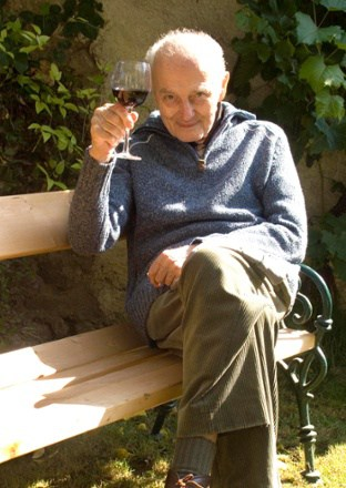 Elderly Man Holding a Glass of Wine