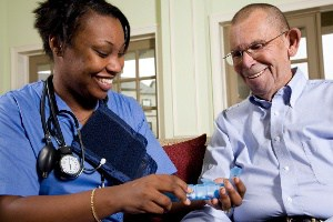 Nurse Sitting with Elderly Man