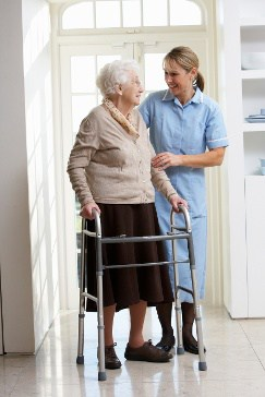 Nurse Helping an Elderly Woman with a Walker