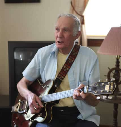 Elderly Man Playing Guitar