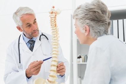 Doctor speaking to a patient about the spine