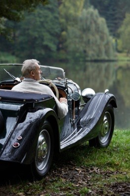 Elderly Man in a Car Next to a Lake