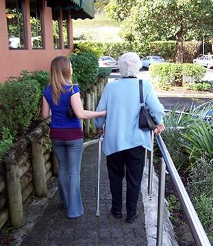 Woman Walking with an Elderly Woman