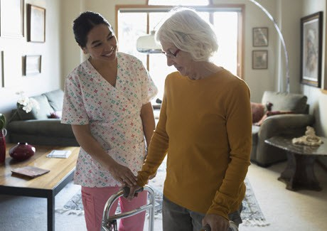 provider of home care in Newmarket walking with senior